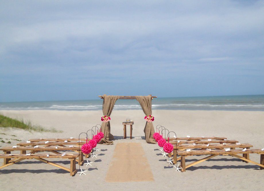 ideas for beach wedding party favors%0A Barn wood benches for beach wedding  Find this Pin and more on Wedding  Arbors by amy gillette  Decorations