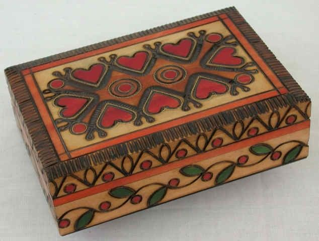 #Wooden #Heart #Box. This Heart Box is hand decorated from Linden wood by skilled artisans. Brass inlay and Red Hearts on lid. Geometric and Vine designs on 3 sides. Wonderful Gift Idea!