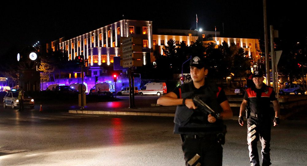 police officers stand guard near the turkish military headquarters in ankara turkey