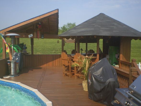 My tiki bar a cool place to hang out its always 5 - Above ground pool bar ...