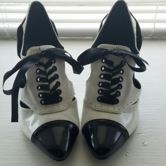 Funtaisma Pumps These black and white pumps are sure to turn heads! Satin laces, good condition. These were only worn twice. Funtaisma  Shoes Heels