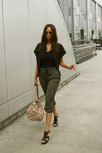 Tyra Banks Casual wear done right. Tyra Banks  cropped olive pants are  comfy enough to travel in but way more cooler than a pair of baggy s. 1fc0c56d7436d