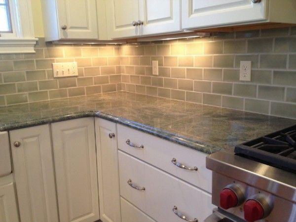 Olive Green Kitchen Countertops Below Duplex Electrical