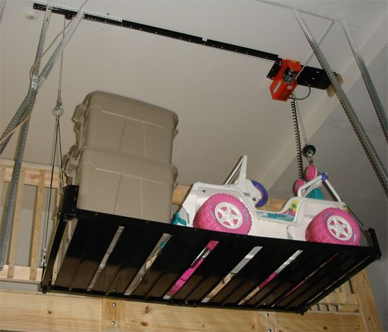 Powered Electric Hoist Which Includes A Metal Platform For Totes
