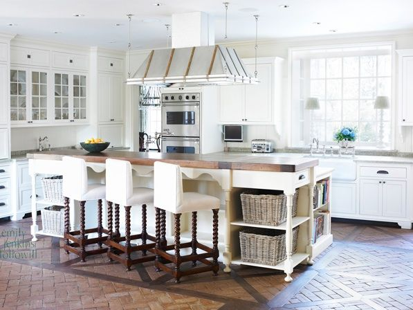 this white kitchen's star power comes from the beautiful brick and