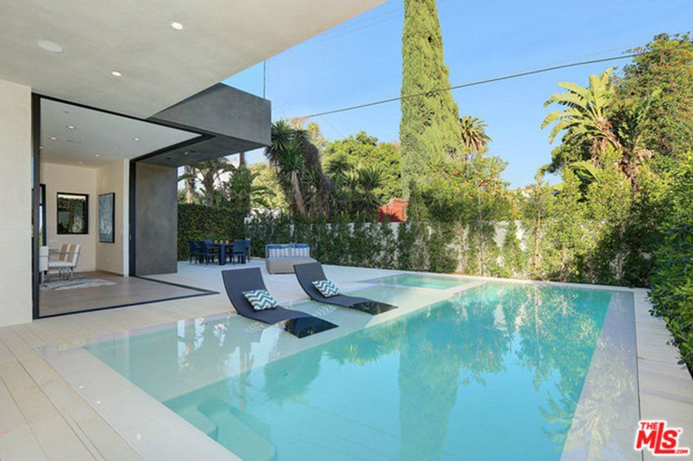 modern pool design with tanning ledge and