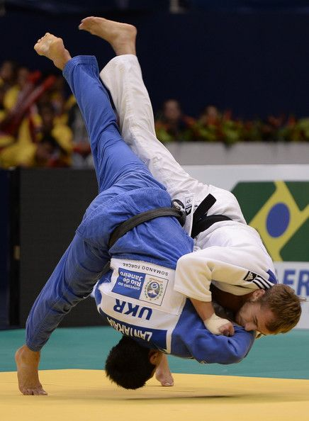 Georgii Zantaraia (blue) of Ukraine fights against Mikhail Pulyaev of Russia, in the -66 kg category during the  World Judo Championships at Maracanazinho gymnasium on August 27, 2013 in Rio de Janeiro, Brazil.