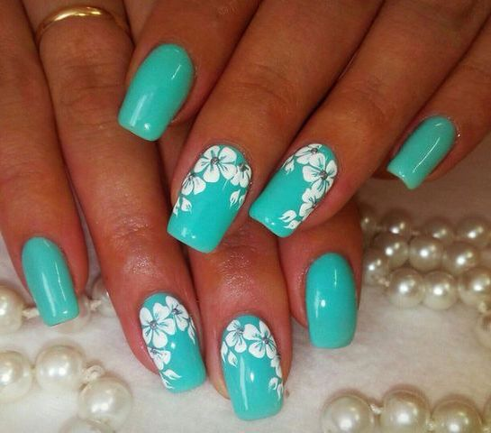 A bright spring manicure made by turquoise gel lacquer, decorated with  snow-white flowers. This contrasting combination of colors allows you to  create an ... - Pin By Polly Henley On Fingernail Art Pinterest Manicure
