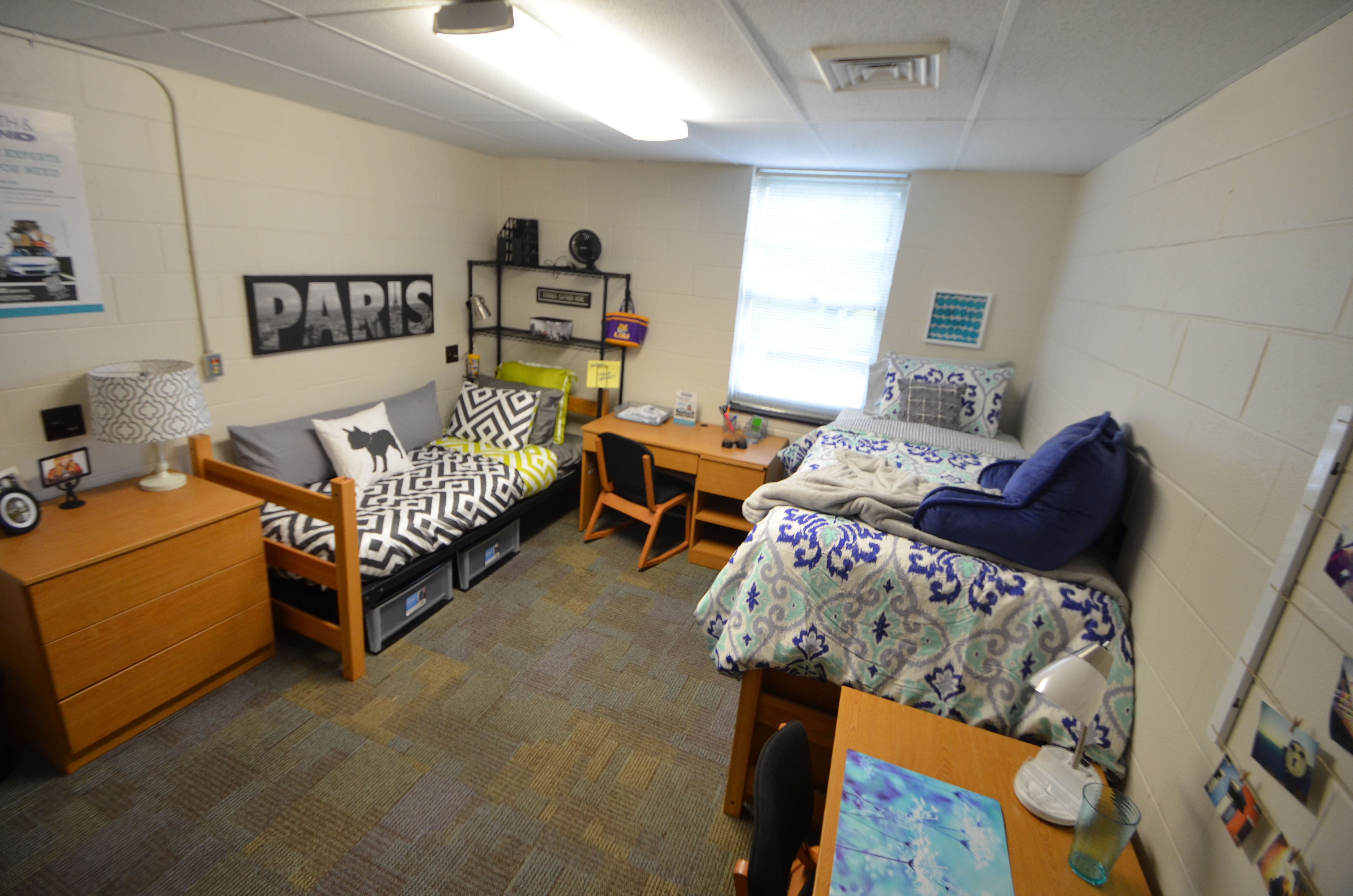 Rooms in Kirby Smith are spacious, with carpeted floors ...