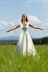 woman in a wedding dress in the field