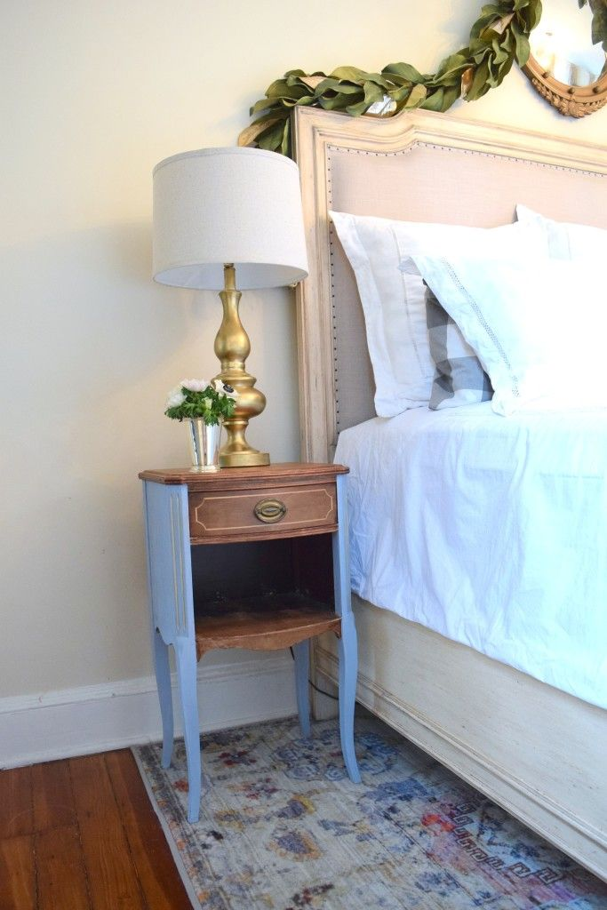 Vintage bedside table or nightstand with nailhead