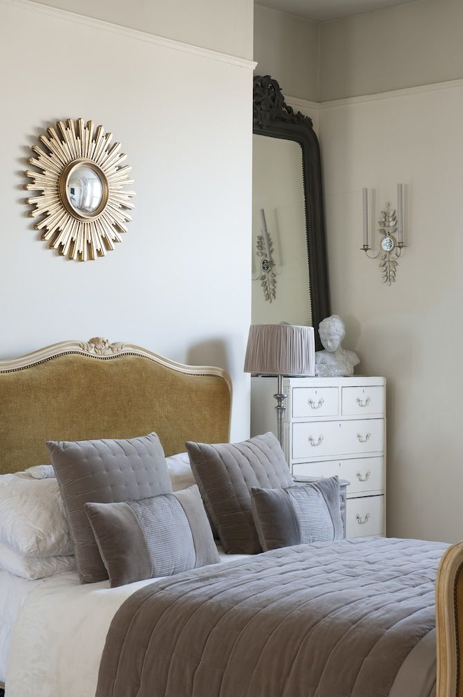 Restful bedroom design features a small gold