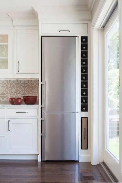 Built in wine rack next to fridge. We won\'t put in a skinny fridge ...