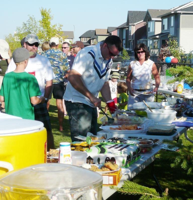 Neighbors meeting neighbors at a block party. www.cooperscrossing.ca #coopersairdrie