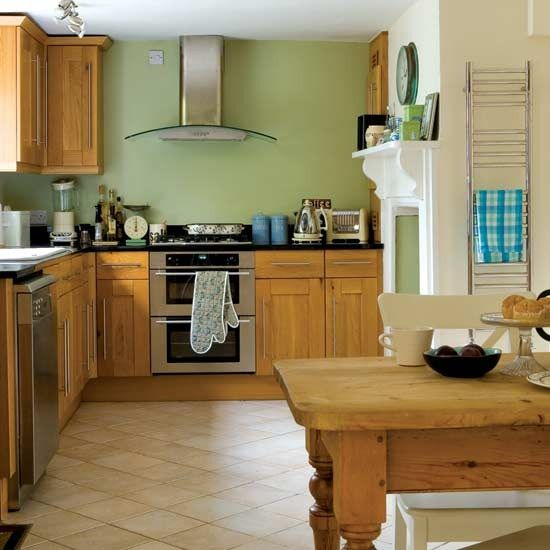 Sage Green Kitchen Walls With Wood Cabinets