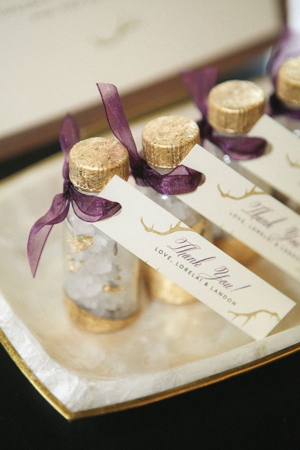 luxurious gold and violet bottled bath salts as Thank You gifts...