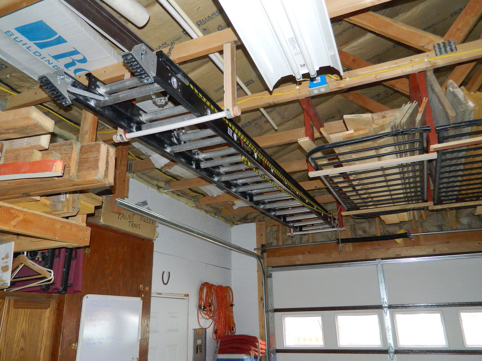 Pin By Chuck Nichter On My Projects I Constructed Etc Ladder Storage Garage Extension Garage Storage Organization