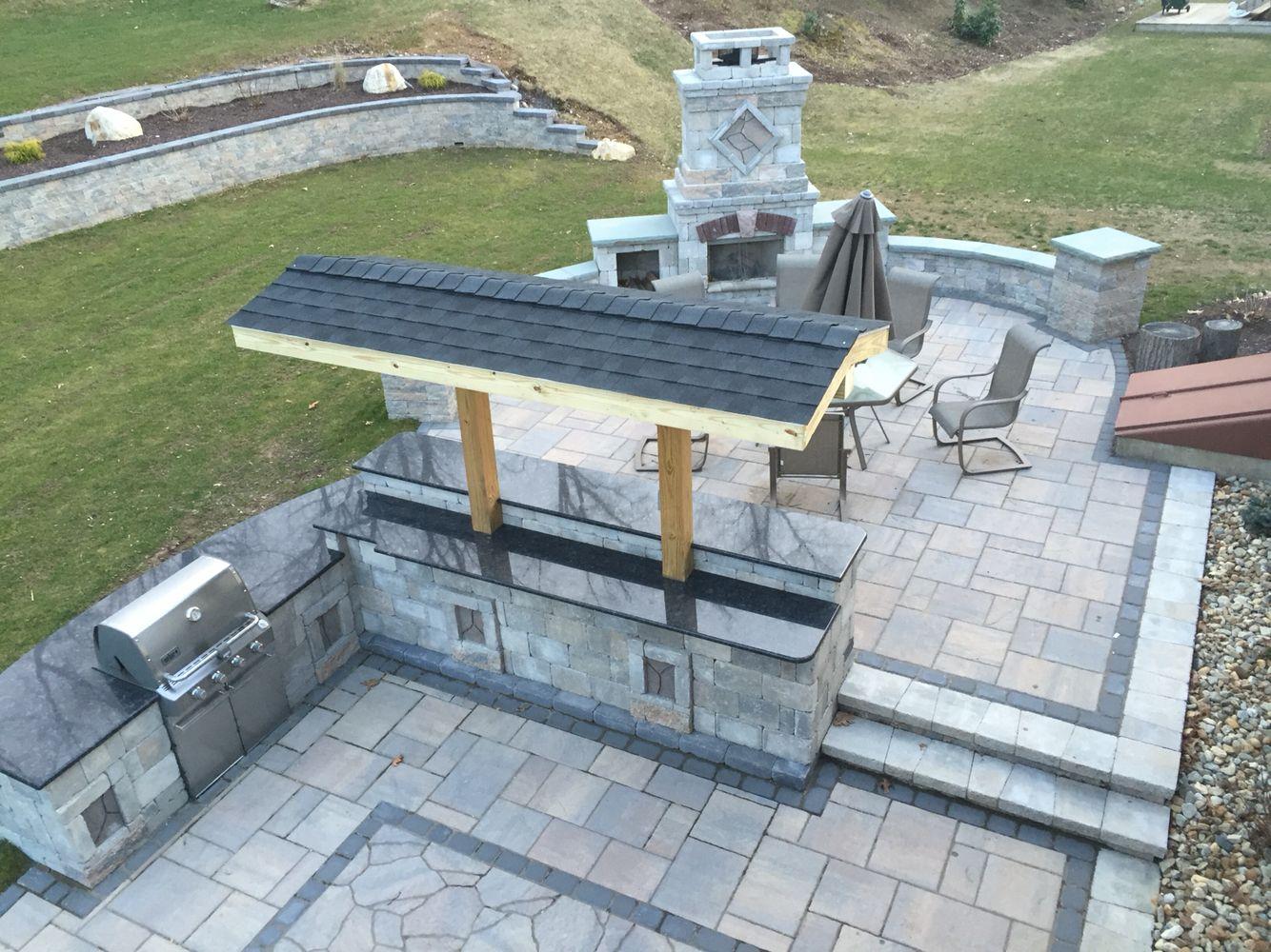 Backyard patio with fireplace,minibar,outdoor kitchen,pillars and ...