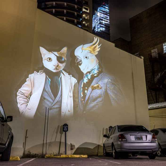 In this series visual artist and founding member of Le3 creative studio, Julien Nonnon, projects  large-scale images of stylish human-animal hybrids, on buildings throughout the city of Orlando, Fl…