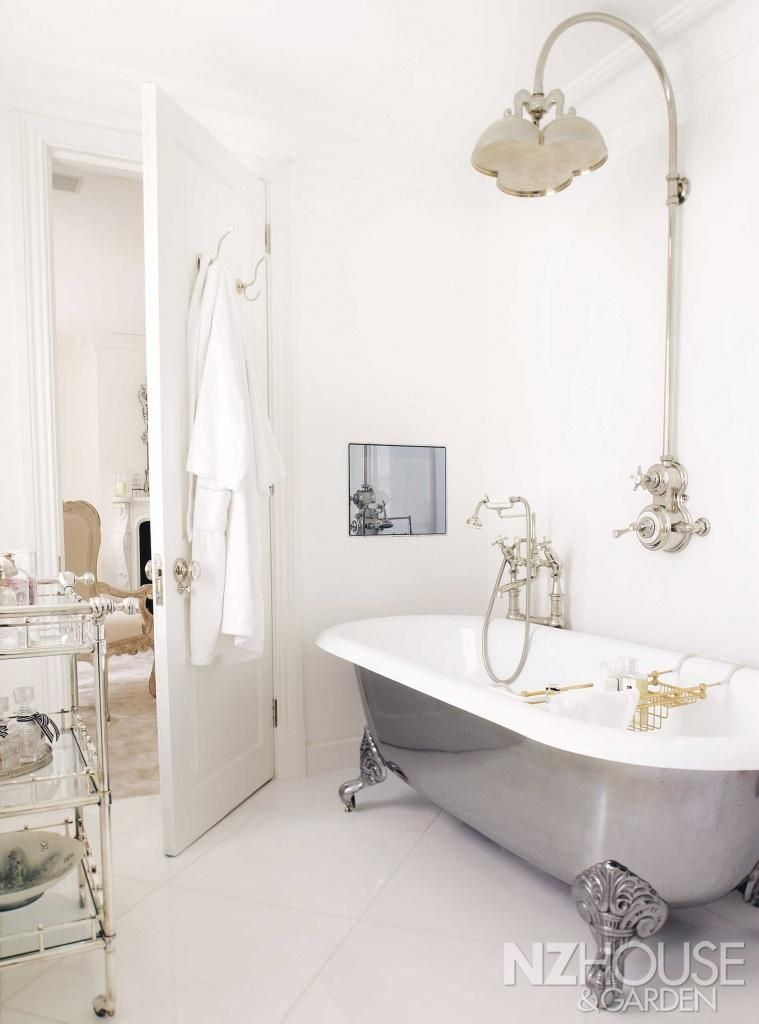 a television screen is built into the wall of alison s en suite rh pinterest com