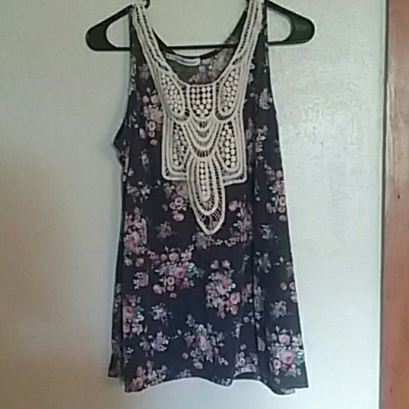 Tank top Maurice's dressy tank top size 0, medium or large. Floral print with crotchet lace on front. Never been worn. No long have the tags. Great summer design, navy color. Maurices Tops Tank Tops