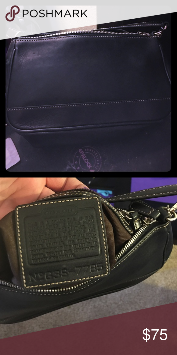 Coach clutch Authentic Coach clutch black in color only used once. No rips or snags in lining Coach Bags Clutches & Wristlets