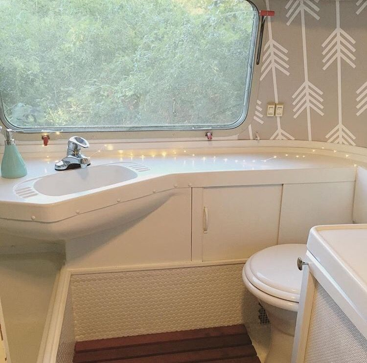 airstream bathroom spa like slat food floors penny tile fairy lights bold