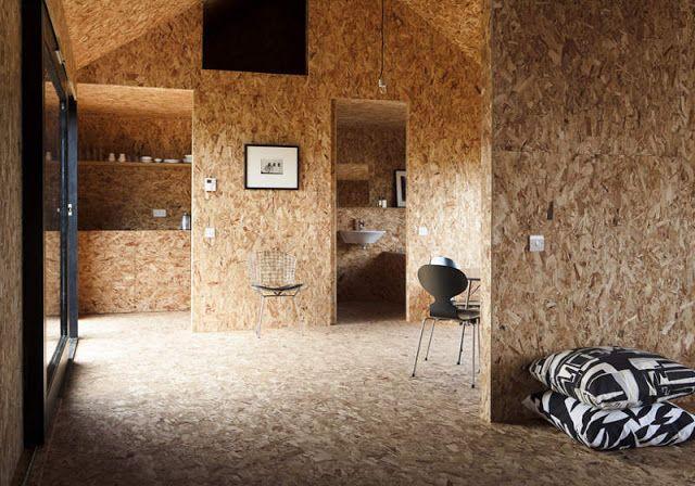 Un granero convertido en una casa de dise o con tableros for Extension maison osb