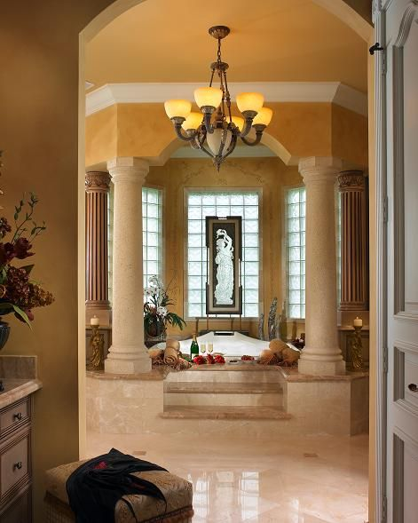 Exquisit Traditional Bathroom with Raised Roman Tub and Column Lined  Enclave built by Landmark Custom Homes