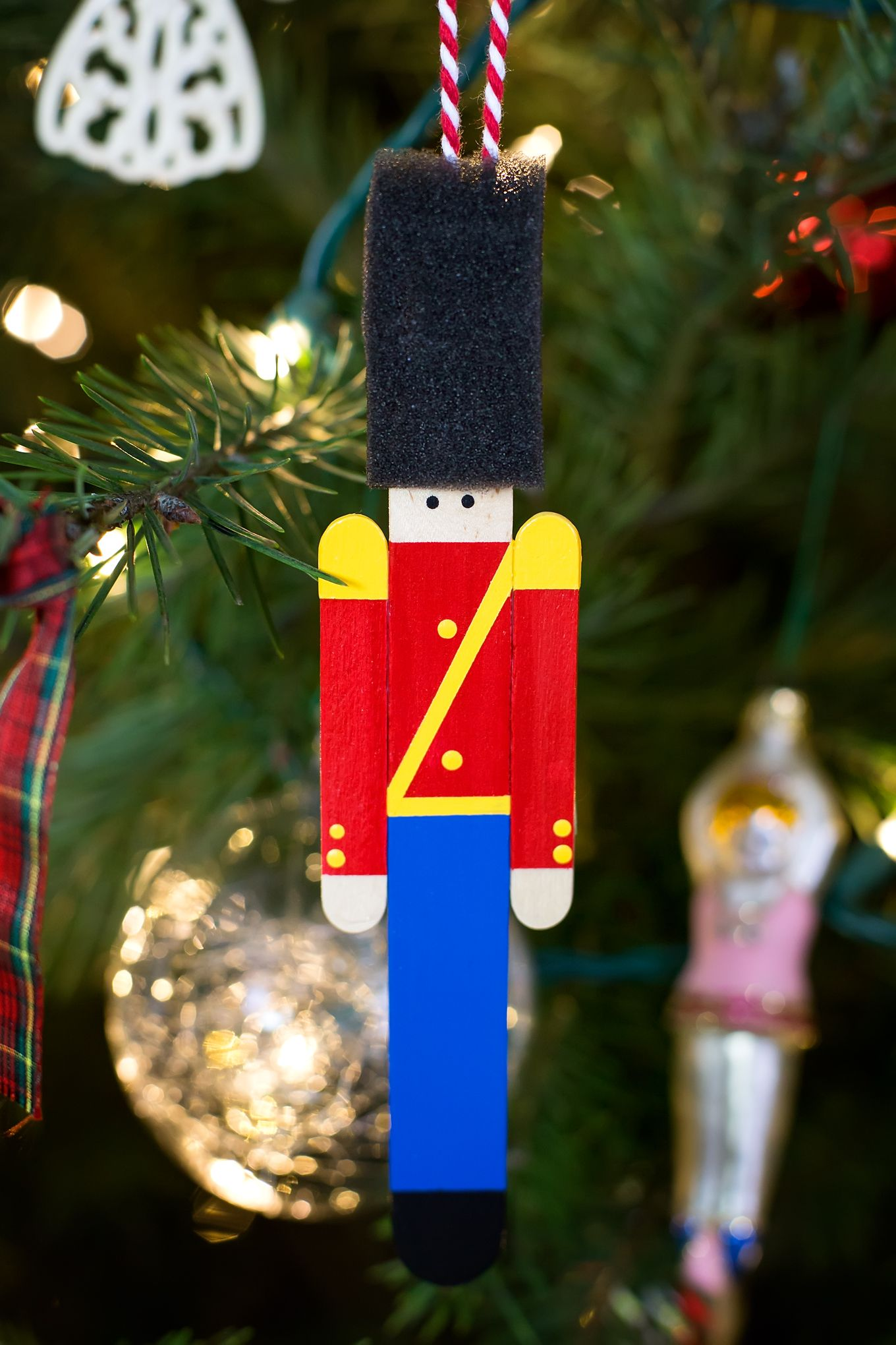 Crafters Big And Small Will Delight In Making A Wooden Toy Soldier Ornament With Craft Sticks Pai Craft Stick Crafts Christmas Crafts Popsicle Stick Ornaments