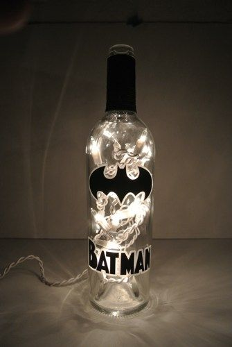 Your choice of 1 upcycled frosted and lighted wine bottle with Batman decorations A standard strand of 20 white lights are included. Great gift! If your favorite super hero is not listed, let us know!