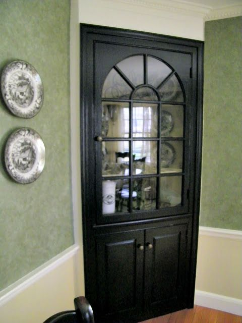 Black Paint Updates A Traditional Dining Room Corner Cabinet
