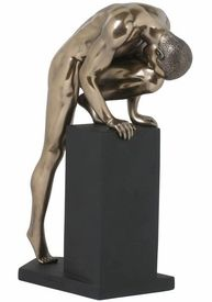 Sculpted Nude Male with Leg on a Pedestal Sculpture