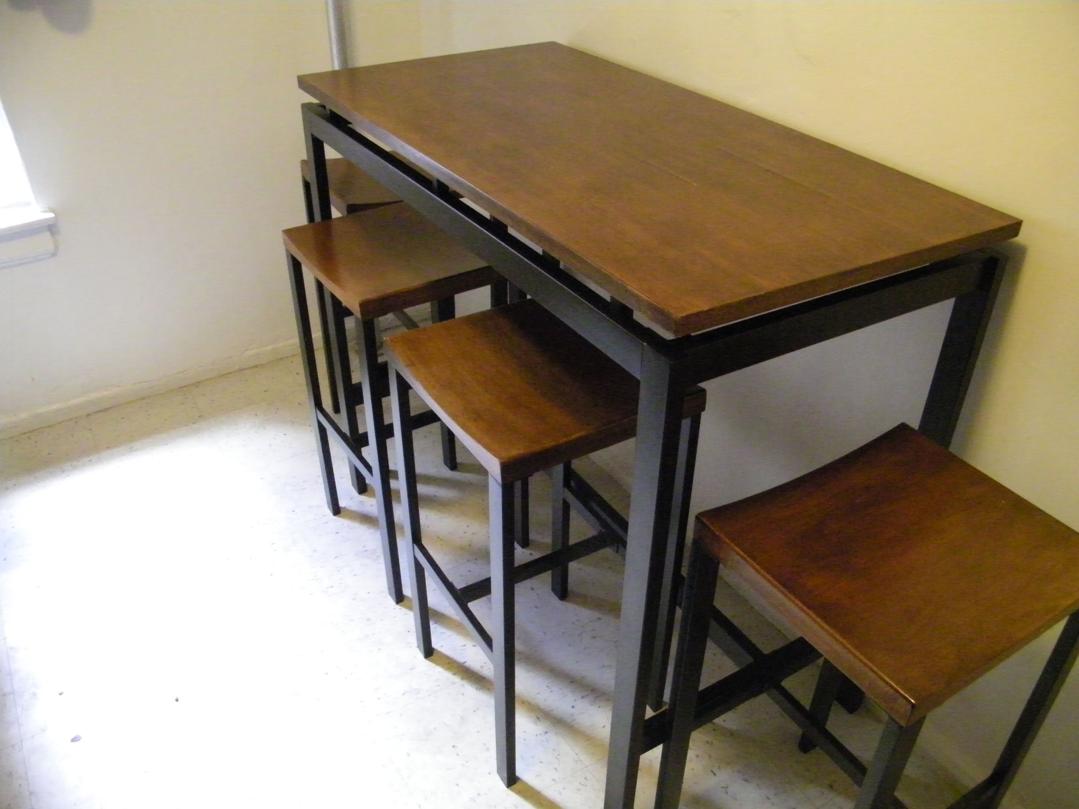 100] Counter-height kitchen table and four stools, about 40 inches ...