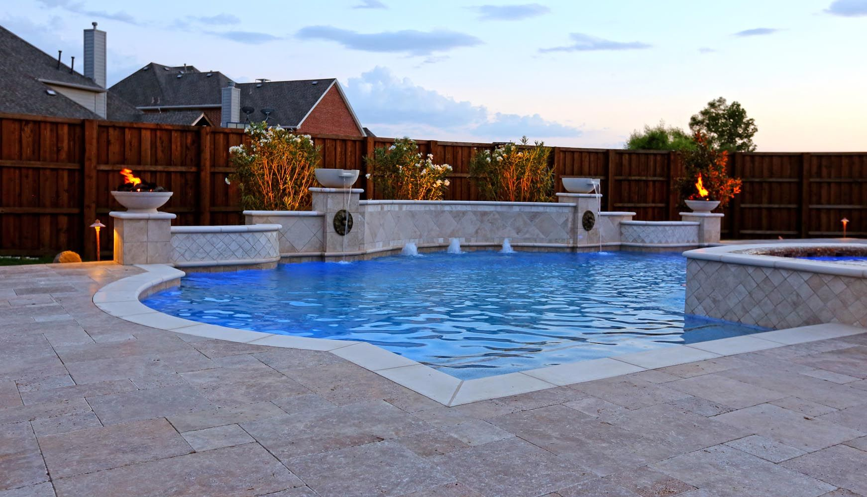 Grecian Pool With Bubblers Led Lighting Travertine Water Bowls And Travertine Walls And Columns In Frisco Geometric Pool Pool Remodel Pool Designs