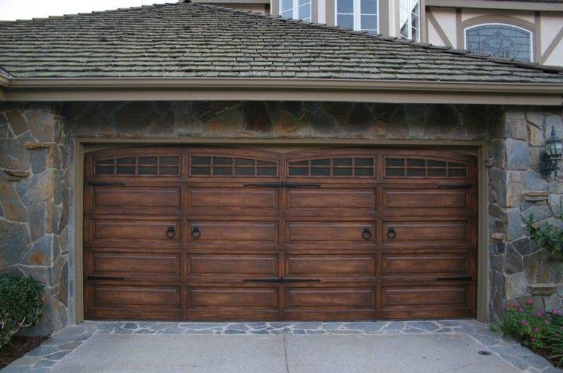 Dark Wooden Garage Arched Garage Door Stone Siding Grey Roof Of
