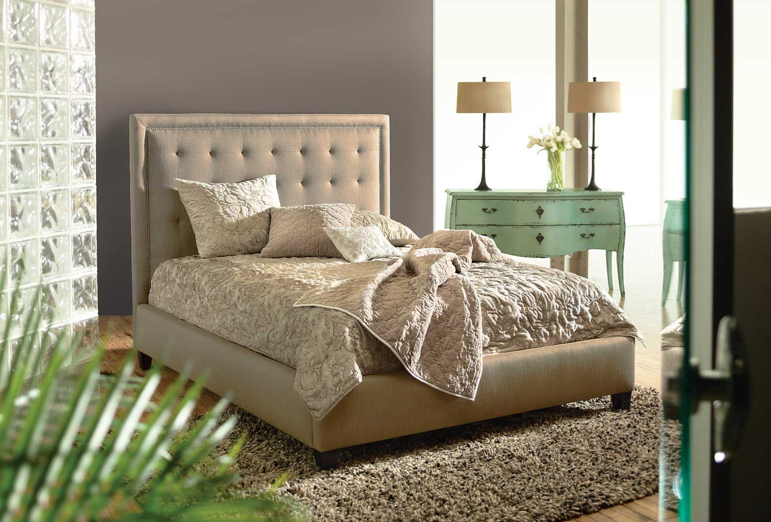 Love the wall color headboard and turquiose accent pieces