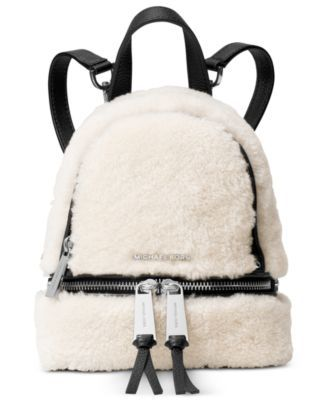 Genuine shearling adds an exquisite touch to a laid-back backpack from Michael Michael Kors, designed to slip effortlessly over your shoulders while jet-setting around the globe or just getting around