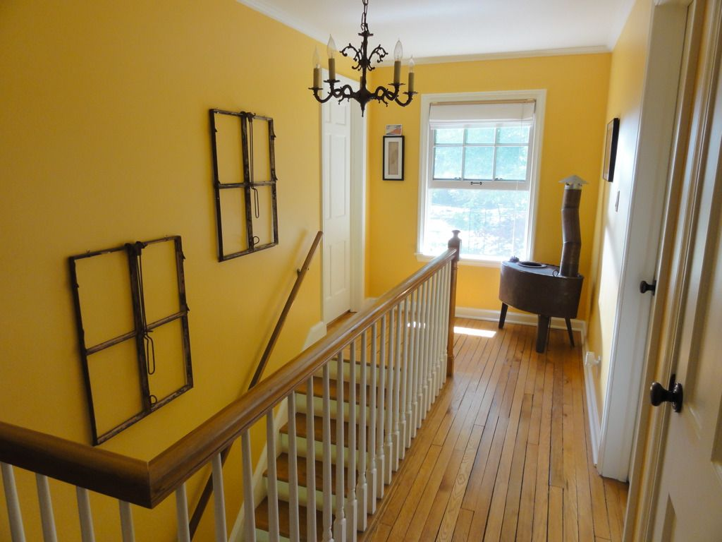 2nd floor hallway. Painted in 2008. Rusty stove in corner and the ...