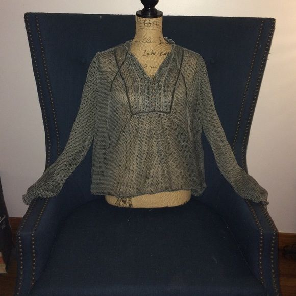 Flirty shirt Cute and fun flirty shirt. Never worn.  Wear this with a camisole and skinny jeans, a cute pair of capris, or a nice dress pant for work. Tops Blouses