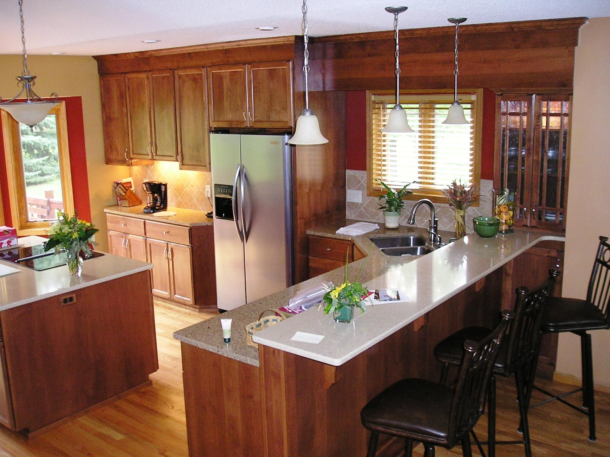 Cherry cabinets with a combination of Silestone and Cambria for a stunning kitchen remodel