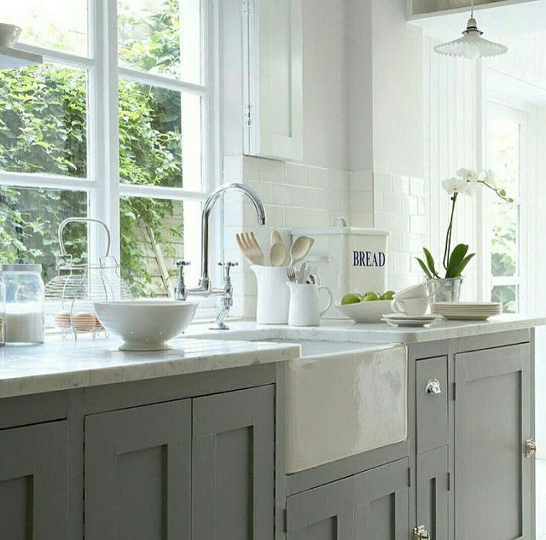 Like the dark grey cabinets and their