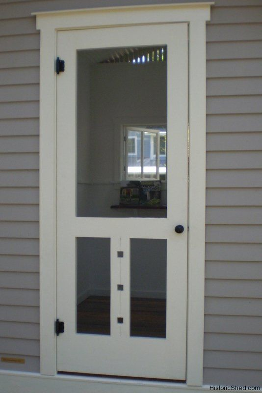 Wood screen door with cutouts in florida by historic shed for Custom storm doors