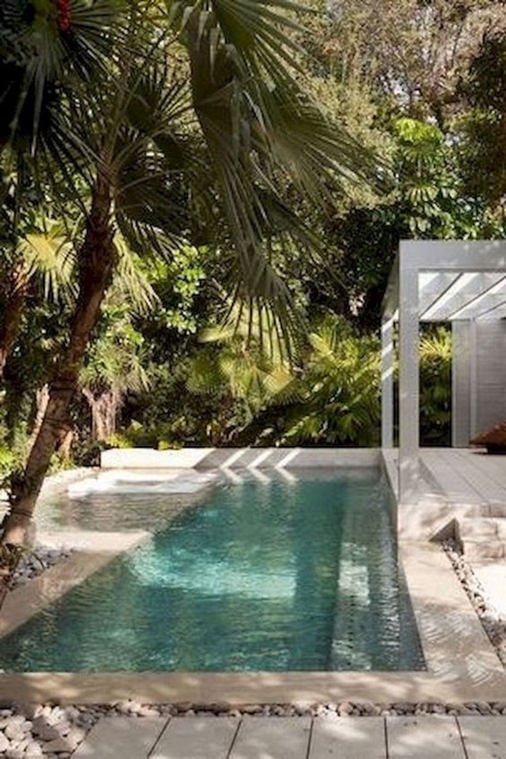 33 Lovely Swimming Pool Garden Ideas To Get Natural Accent Pimphomee Rectangular Swimming Pools Cool Swimming Pools Amazing Swimming Pools