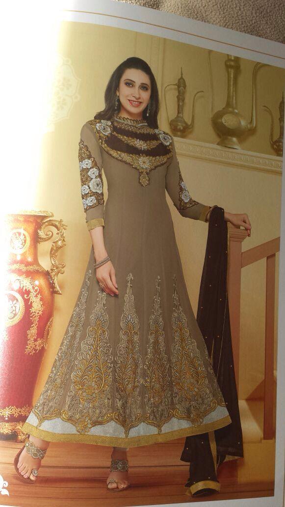 Karishma kapoor in a gray anarkali dress