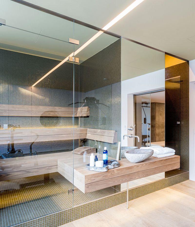 This ultra modern bathroom has light wood flooring