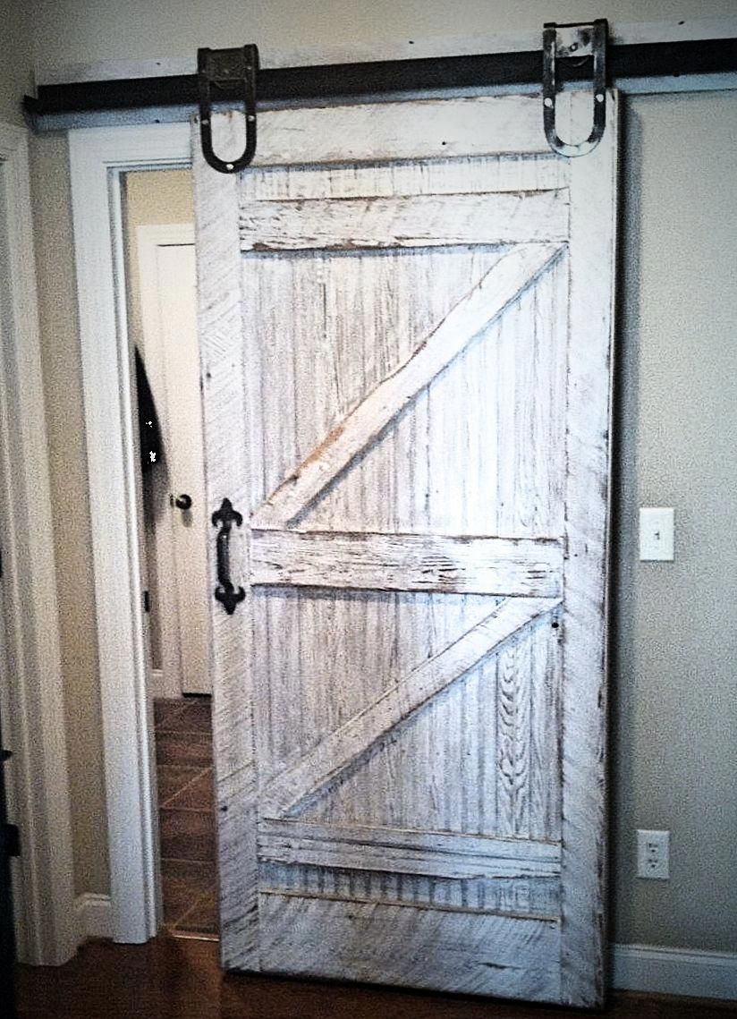 White Washed Barn Door With Visible Saw Marks Mild Distress And Some Adorbale Horseshoe Style Wheels To H White Barn Door Barn Doors Sliding Rolling Barn Door