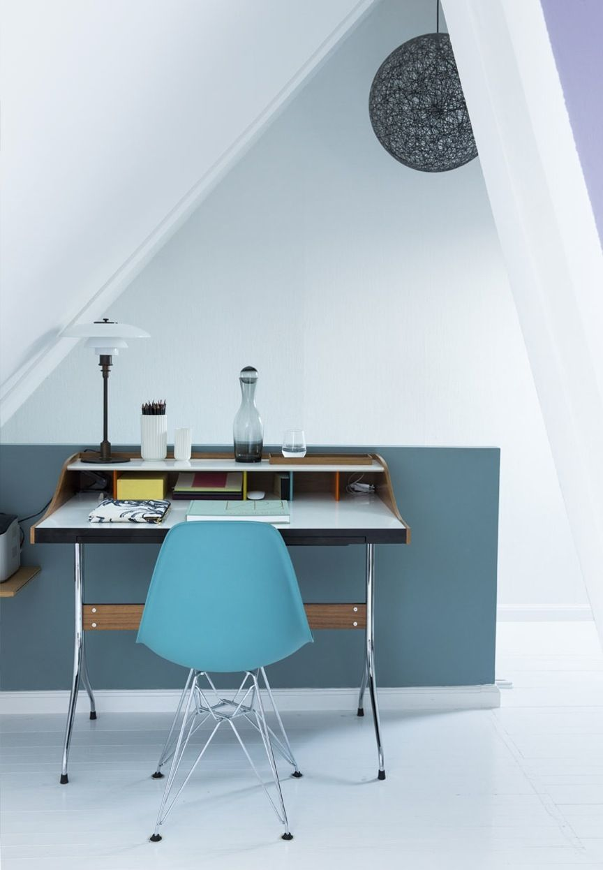Simple and small home office with sloping