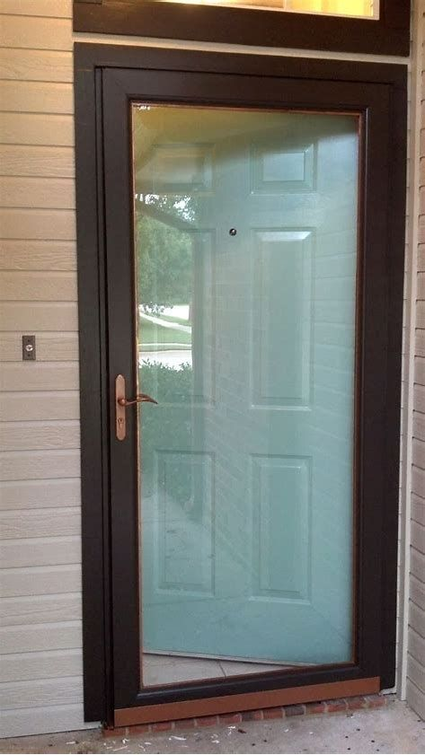 Mounting A Storm Door Is One Of The Most Intelligent Home Solutions You Can Carry Out Before Cold Fall Glass Screen Door Glass Storm Doors Painted Front Doors