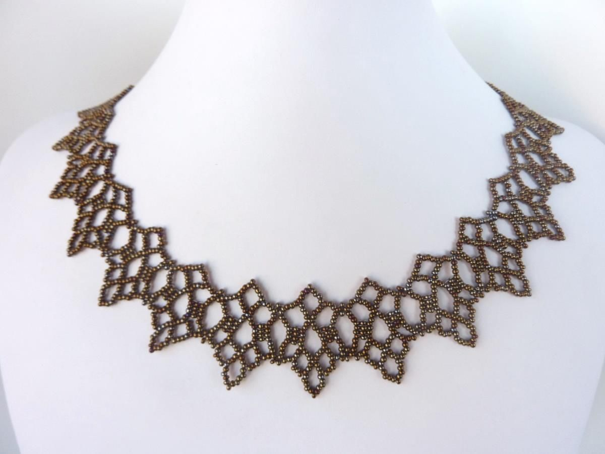 FREE beading pattern for a beaded lace necklace, made entirely from 11/0 seed beads. Truly an elegant and unique design.